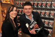 Snooker star Jimmy White signs a book for Kirsty Lount's father at Waterstones Coney Street
