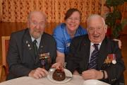 Tasting a Co-operative Christmas Pudding are Bob Ryder,93 (left) and Malcolm Sutcliffe, 92 (right) with care assistant Dawn Taylor from the Royal British Legion's Lister House in Ripon, North Yorkshire.