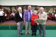 Muriel Thomlinson presents the cup to winners, from left, John Tooms, Roger McCann, and Gordon Fratson