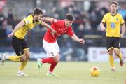 York City's Diego De Girolamo gets away from AFC Wimbledon player Sammy Moore in last weekend's 3-2 League Two defeat at Bootham Crescent