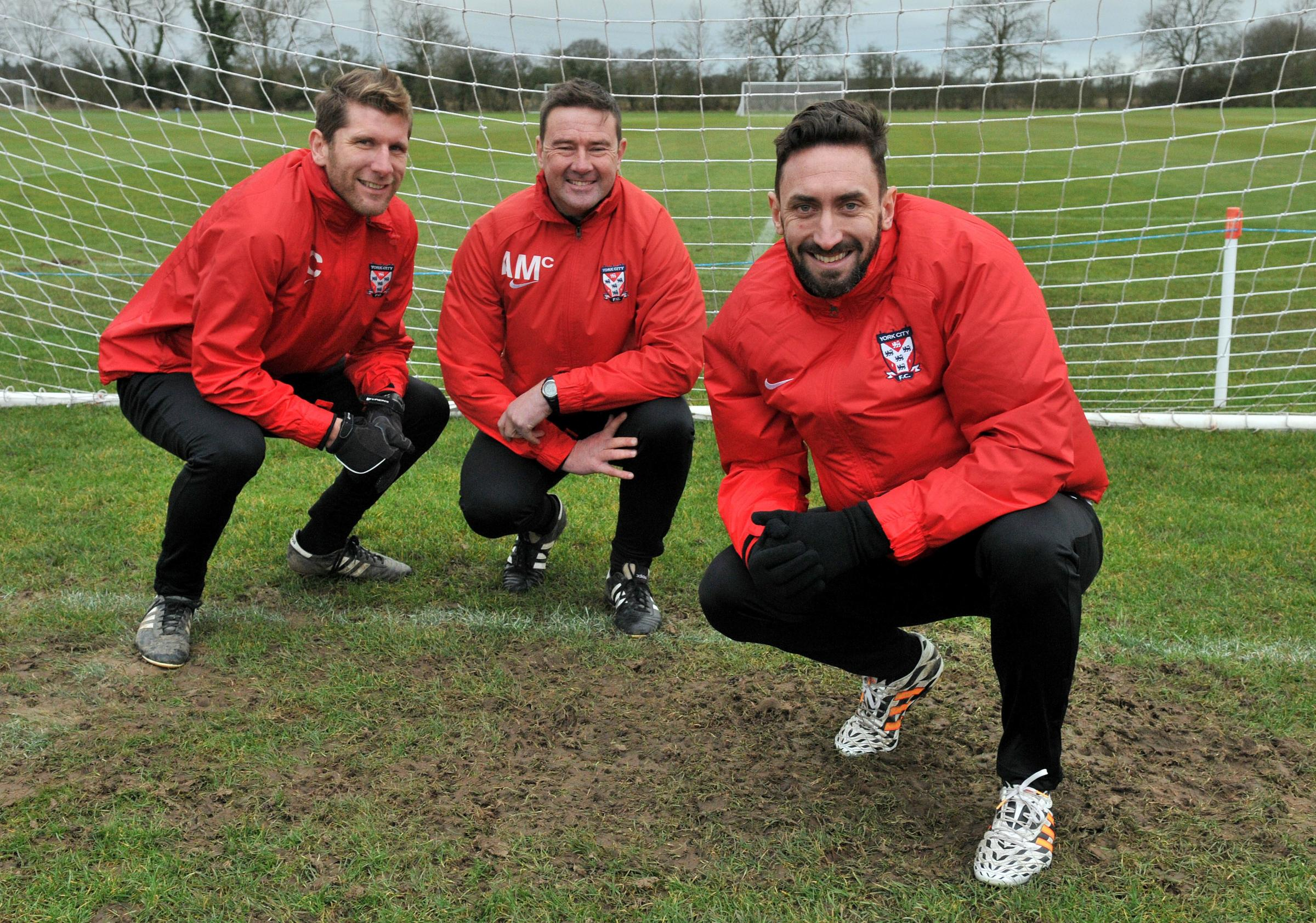 Jonathan Greening, right, with Richard Cresswell, far left, and academy manager Andy McMillan