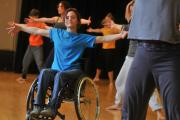 Teacher Laura Jones takes a warm-up session during Stopgap Dance Company's course on inclusive dance and disability