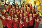 Burton Green School head teacher Karen Tatham, centre, with staff and pupils celebrate their good Ofsted report