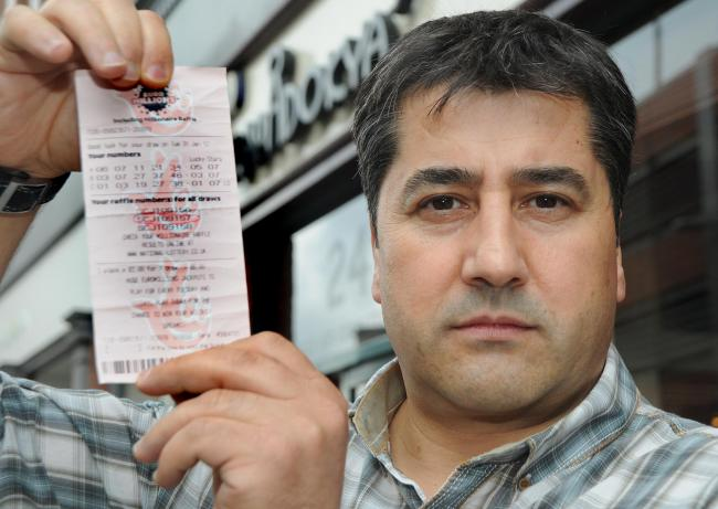 Hayati Kucukkoylu, of the Kapadokya Turkish restaurant in York, with the winning Euromillions ticket