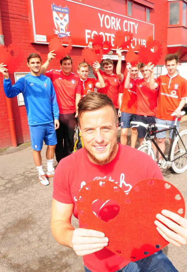 CITY PALS PELOTON: The cyclists have gained support from, forefront, York City goalkeeper Michael Ingham