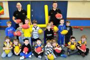 Coach Mark Tipping and assistant Jamie Bingle with youngsters at the Rugbees session