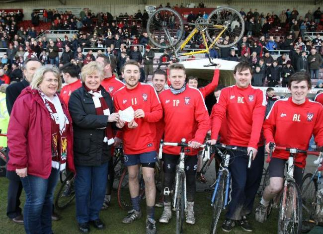 JOURNEY'S END: Organiser Ian Jones hands over the fruits of the York City fans' cycling labours