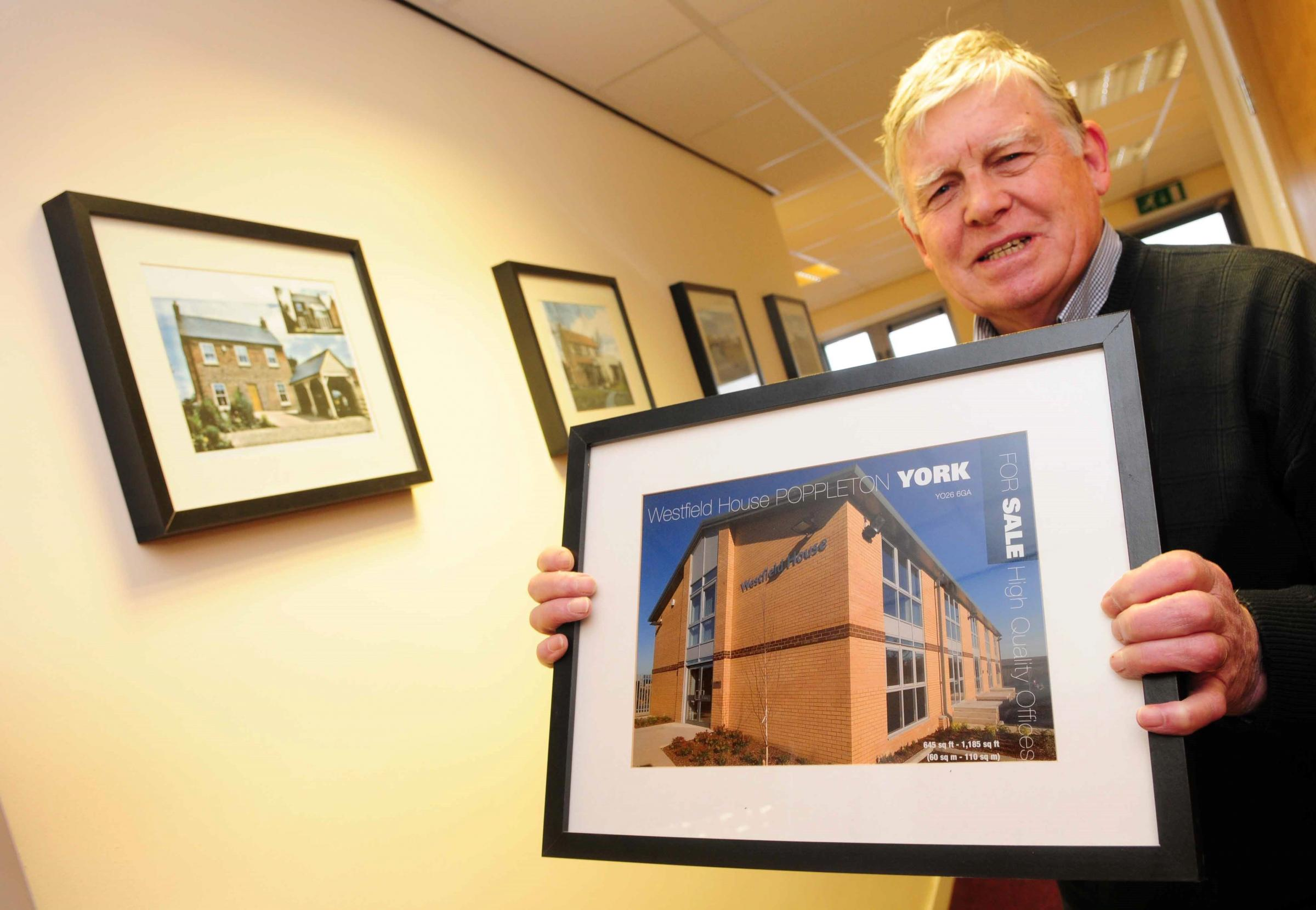 Builder John Butler pictured with some completed projects at his Nether Poppleton head office