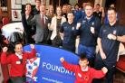 CHEERS: Burton Green pupils Kleo Falcone, left, and Kaiden Butler join York City chairman Jason McGill, Paula Stainton and staff at York City Foundation after they were given charitable status