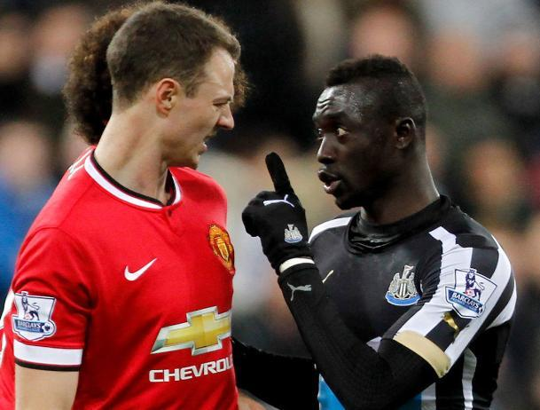 POINTED EXCHANGE: Papiss Cisse, right, remonstrates with Jonny Evans at the Spitgate at Gallowgate inciden