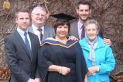 Karen, centre, on her graduation day with, from left, her eldest son Lee, husband Paul, youngest son Craig and mother-in-law Olwyn