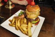 Laura Charles of The Cross Keys, Hillam, with one of the pub's giant burgers