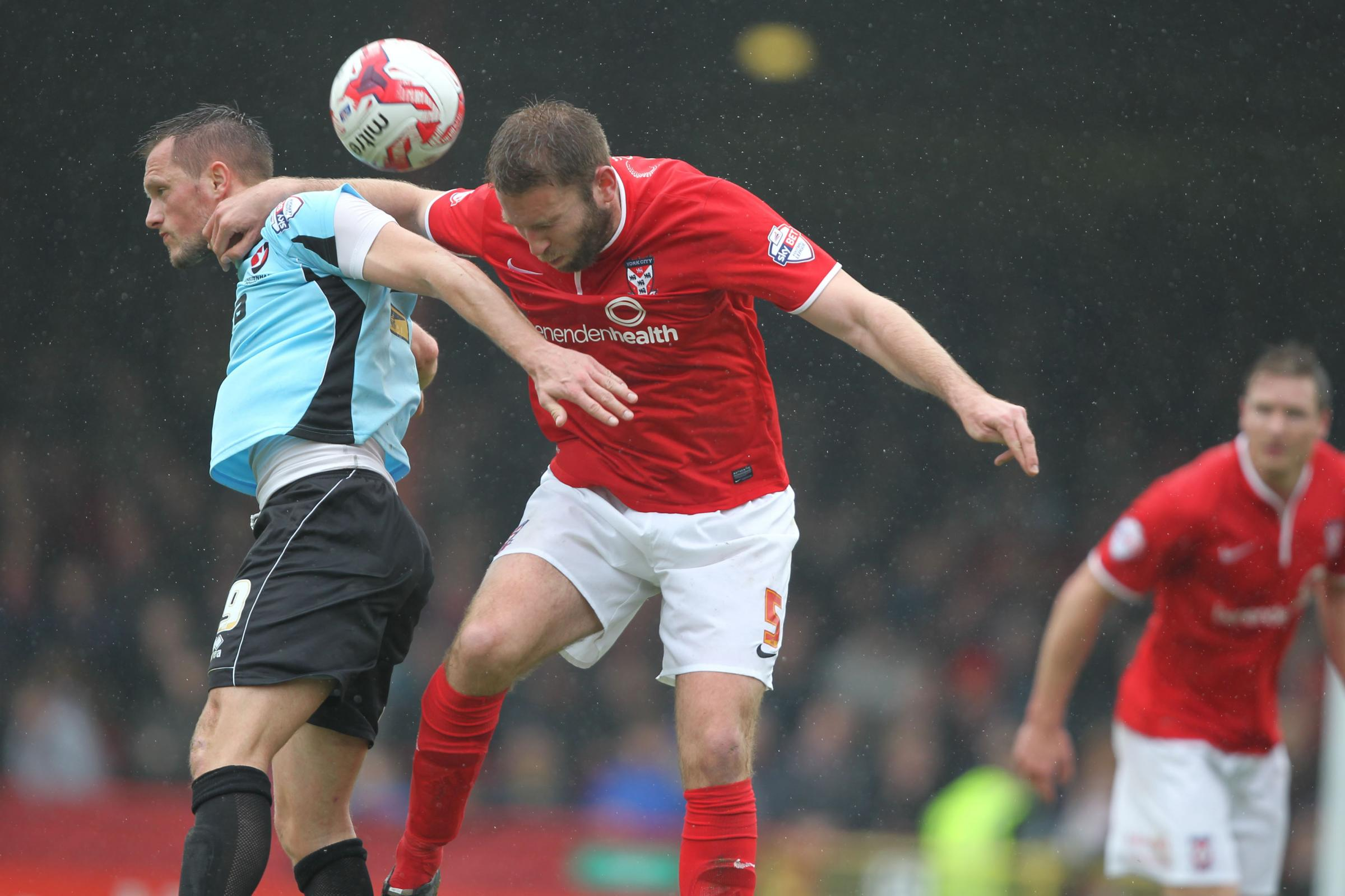 HEADING IN THE RIGHT DIRECTION: John McCombe in aerial action during York City's vital 1-0 victory over Cheltenham