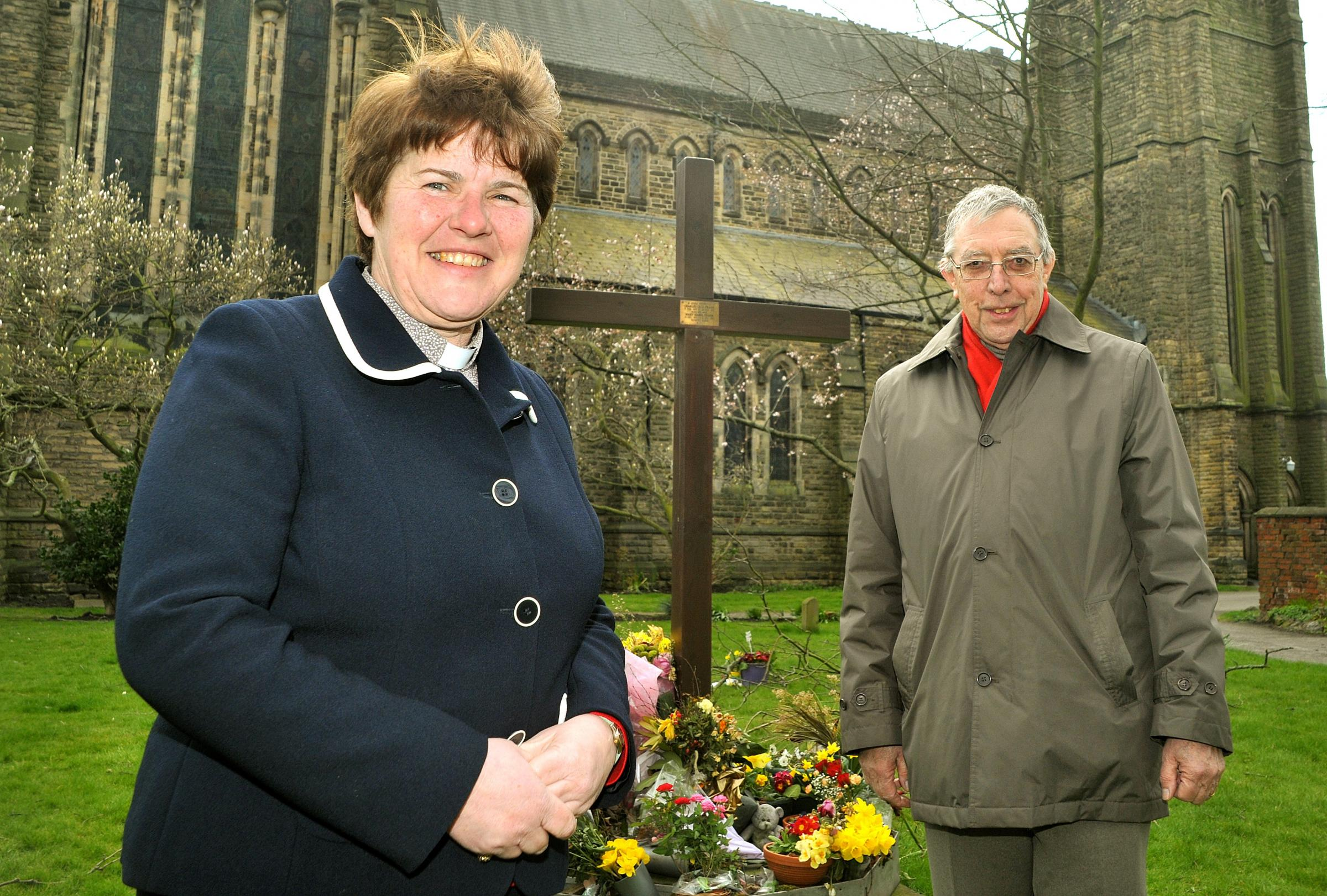 Pictured outside St Lawrence Church are Jane Nattrass with church warden Alan Reed