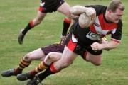 OVER THE WHITEWASH: New Earswick All Blacks player coach Jack Stearman plunges over the line for his side's only try in a 54-6 defeat to Morley Borough