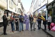 Traders from Stonegate in York, along with street performer Purpleman, take part in a clean-up of their street