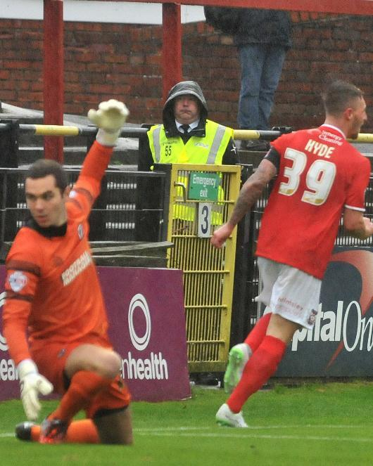 RARE SIGHT: Jake Hyde turns away after scoring past AFC Wimbledon goalkeeper James Shea at Bootham Crescent