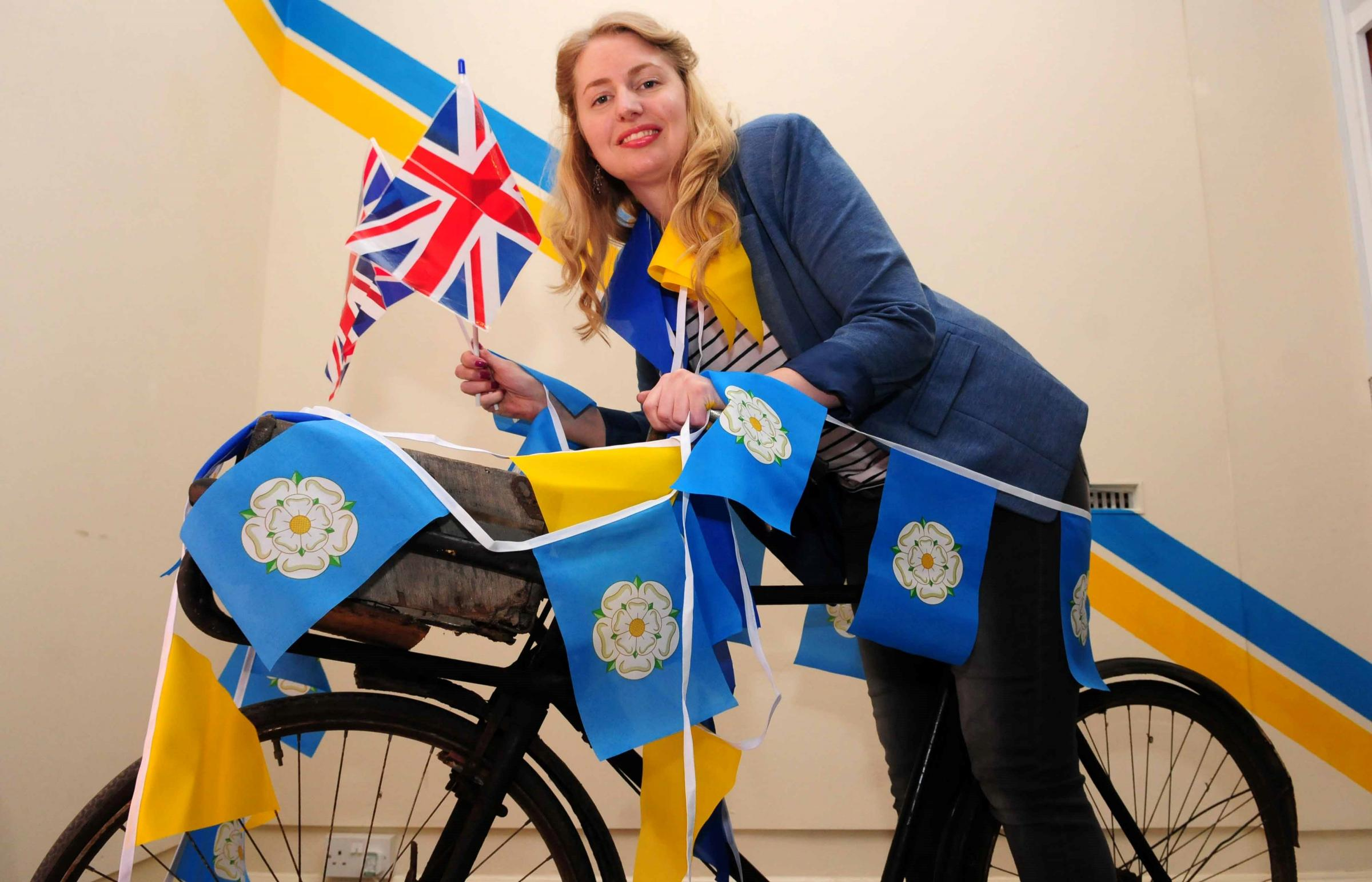Beck Isle Museum's Kerry Metcalfe installs a Tour de Yorkshire-themed exhibit