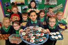 Yearsley Grove School pupil Eleanor Gurung, front, and school friends who held a fundraising bun sale in the school to raise money for disaster relief in Nepal