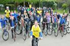 Summer Benn, ten, and pupils from Clifton Green Primary School take part in their own Tour de Yorkshire