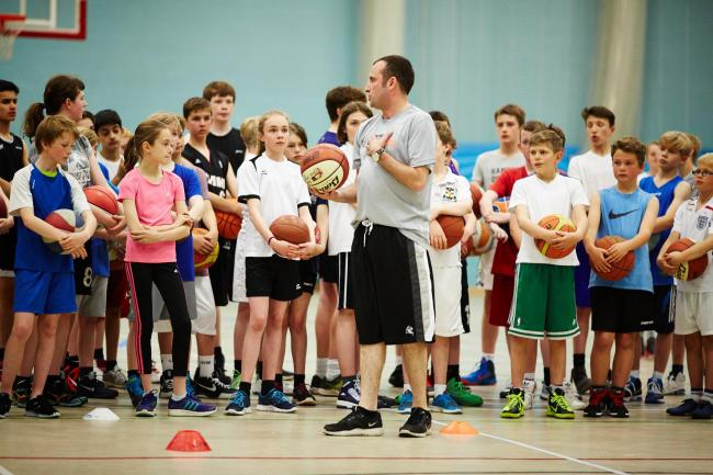 THE FORCE IS WITH US: Matt Newby passes on some tips to York Eagles Junior Basketball Club