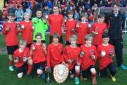 RHAPSODY IN RED: Under-12s cup conquerors Huntington