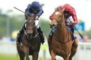 TUSSLE: Star of Seville, ridden by Frankie Dettori, right, beats Together Forever to win The Tattersalls Musidora Stakes
