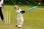 St Wilfrid's Primary School batsman Ethan Caisley hits a four against St Barnabas in the Drax Cup qualifier at Acomb Cricket Club