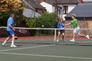Heworth's Nick Latcham, watched by team-mate Oliver Hicks, intercepts for another winner past Starbeck 2's John Berger, left, in division five of the Tyke Petroleum Men's Tennis League