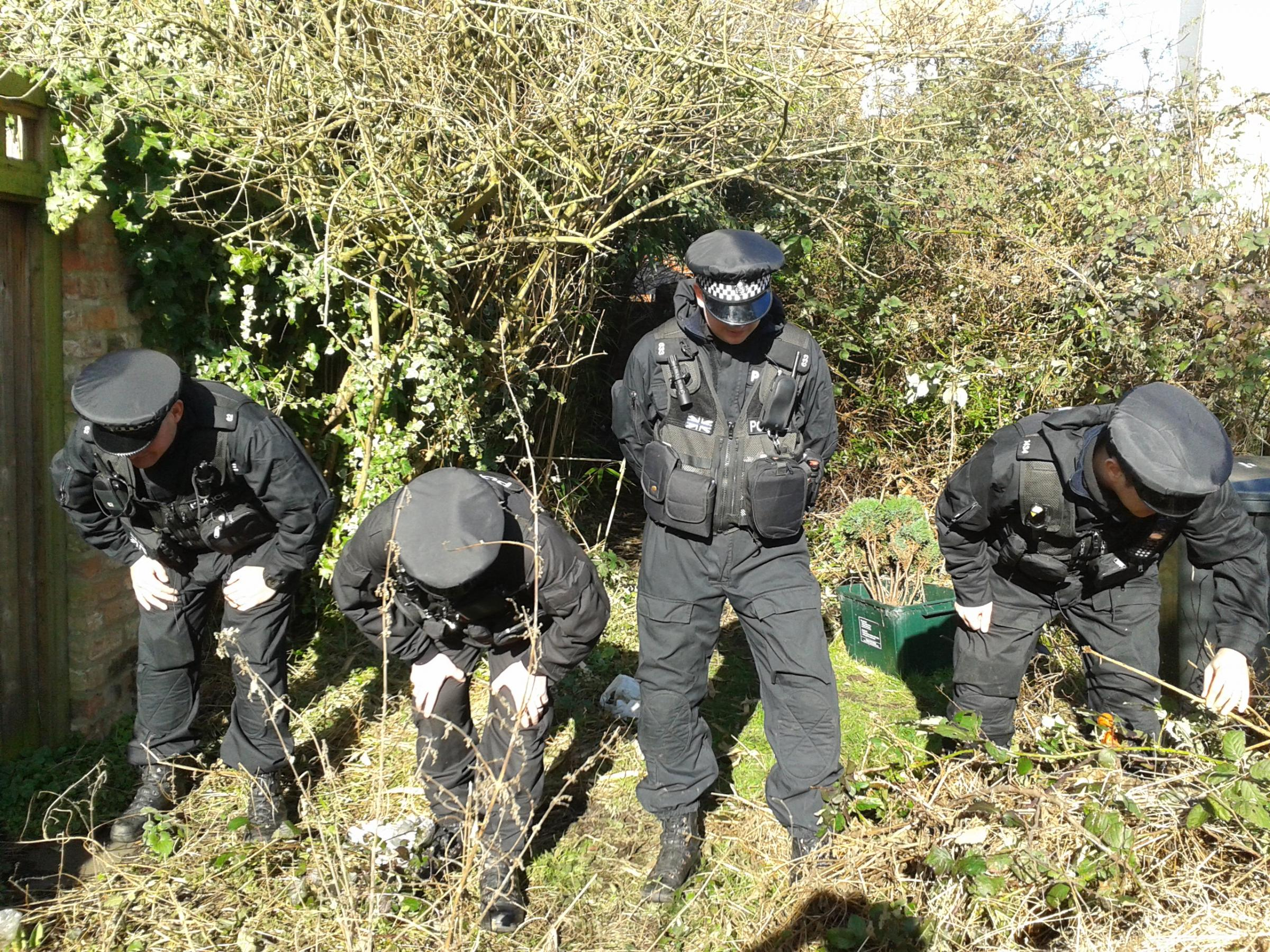 Police carry out a search of the alleyway behind Claudia Lawrence's home in Heworth, York