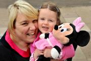 Vicky Allan, from House Martins Day Nursery, with April Benton who is off to Disneyland Paris