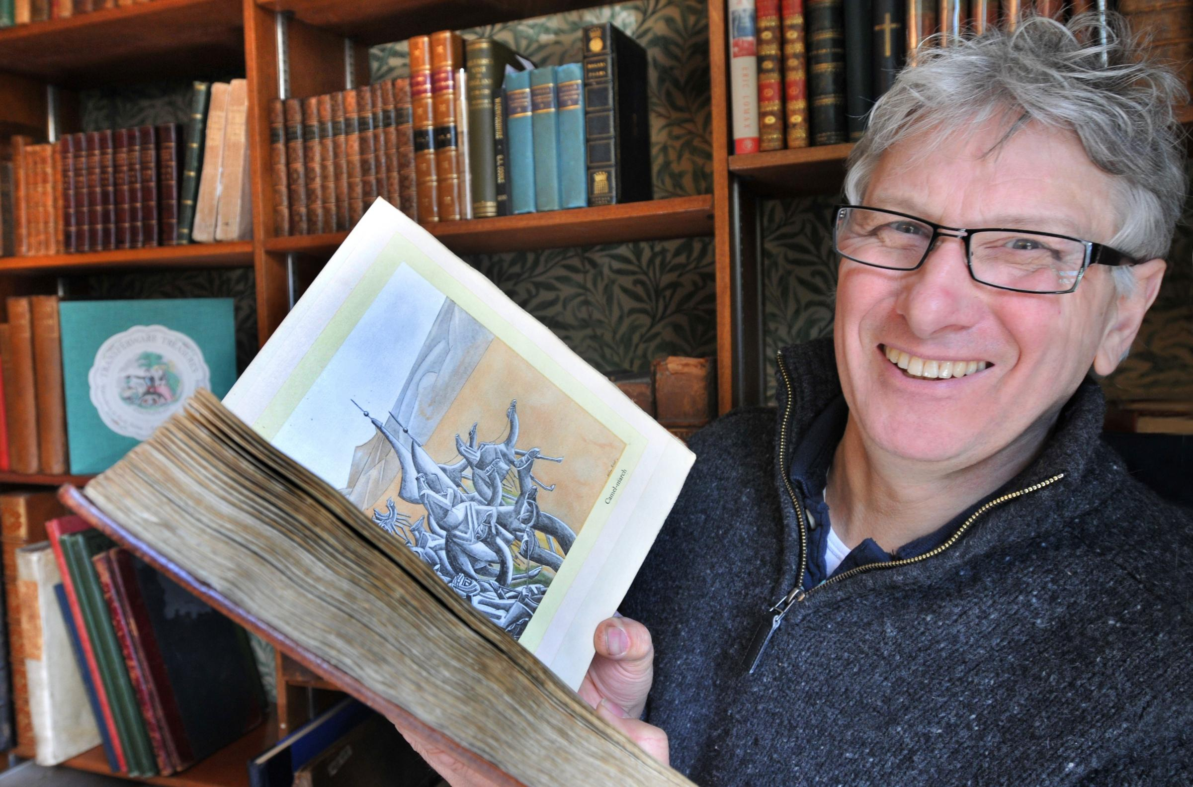 Tony Fothergill with the 1926 first edition of T.E. Lawrence's book The Seven Pillars of Wisdom which is being offered for sale at York booksellers Ken Spelman, of Micklegate