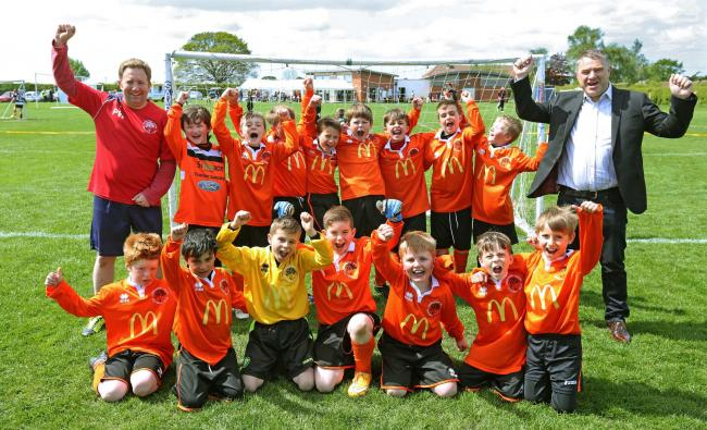 McDonald's franchisee John Atherton presents a new kit to Poppleton Under-9s               Picture: Richard Doughty