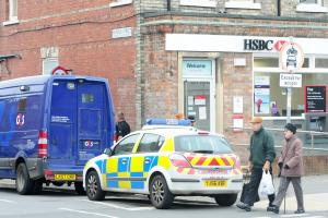 YORK BANK ROBBERIES: 4 jailed for raids on vans - sentences total 23 years