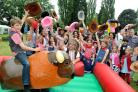 George McVey on the Bucking Bronco with school friends and volunteers at the Appleton Roebuck Primary School Gala, this year with a Wild West theme. Picture: David Harrison
