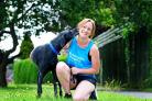 Becky Holmes and her running partner Murphy. Picture by Anthony Chappel-Ross