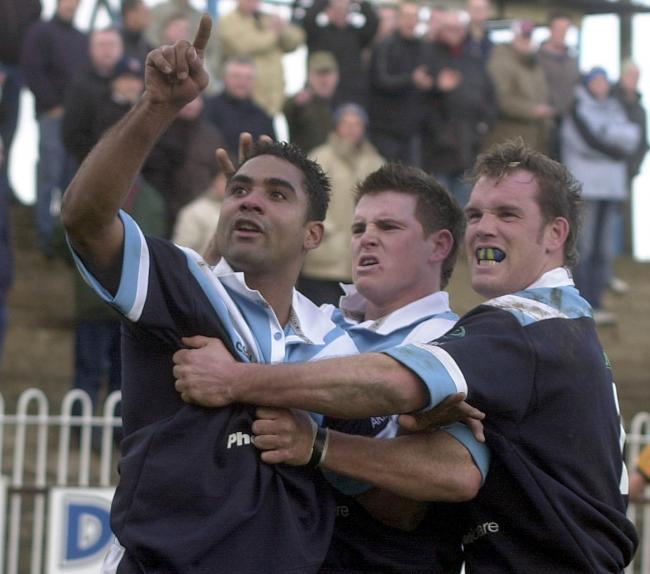DAD: Alex Godfrey, left, celebrates his match-winning try as York City Knights beat Featherstone in a memorable 2004 Challenge Cup tie, despite having played most of the game a man down