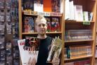 Travelling Man manager Ben Goldsmith with copies of Mark Millar's books