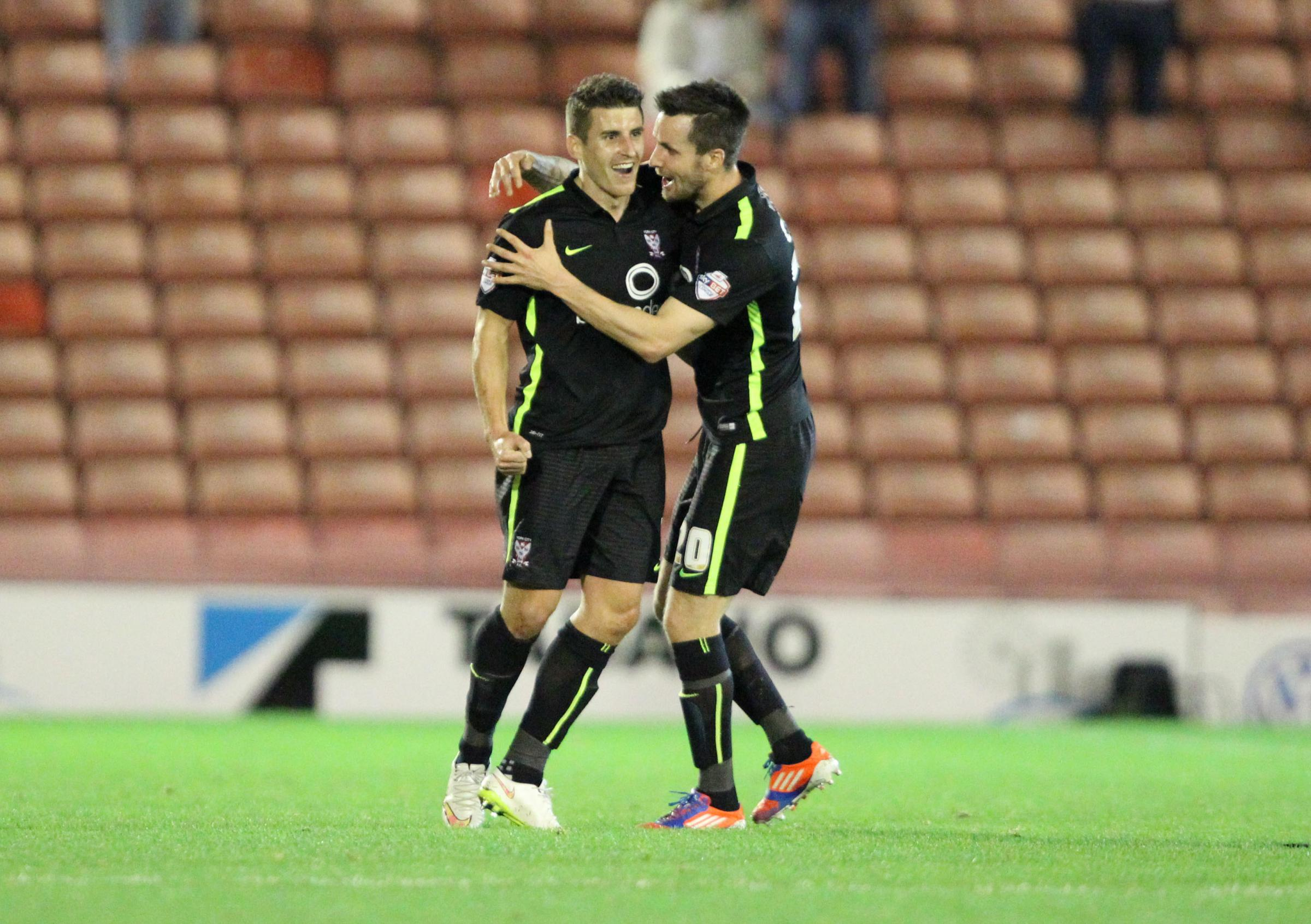 FIVE STAR: Michael Coulson (left) celebrates his fifth goal of the season at Barnsley with team-mate Michael Collins. Picture: Gordon Clayton