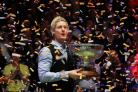 TRIUMPHANT: Neil Robertson celebrates with the Champion of Champions trophy Picture: Tai Chengzhe