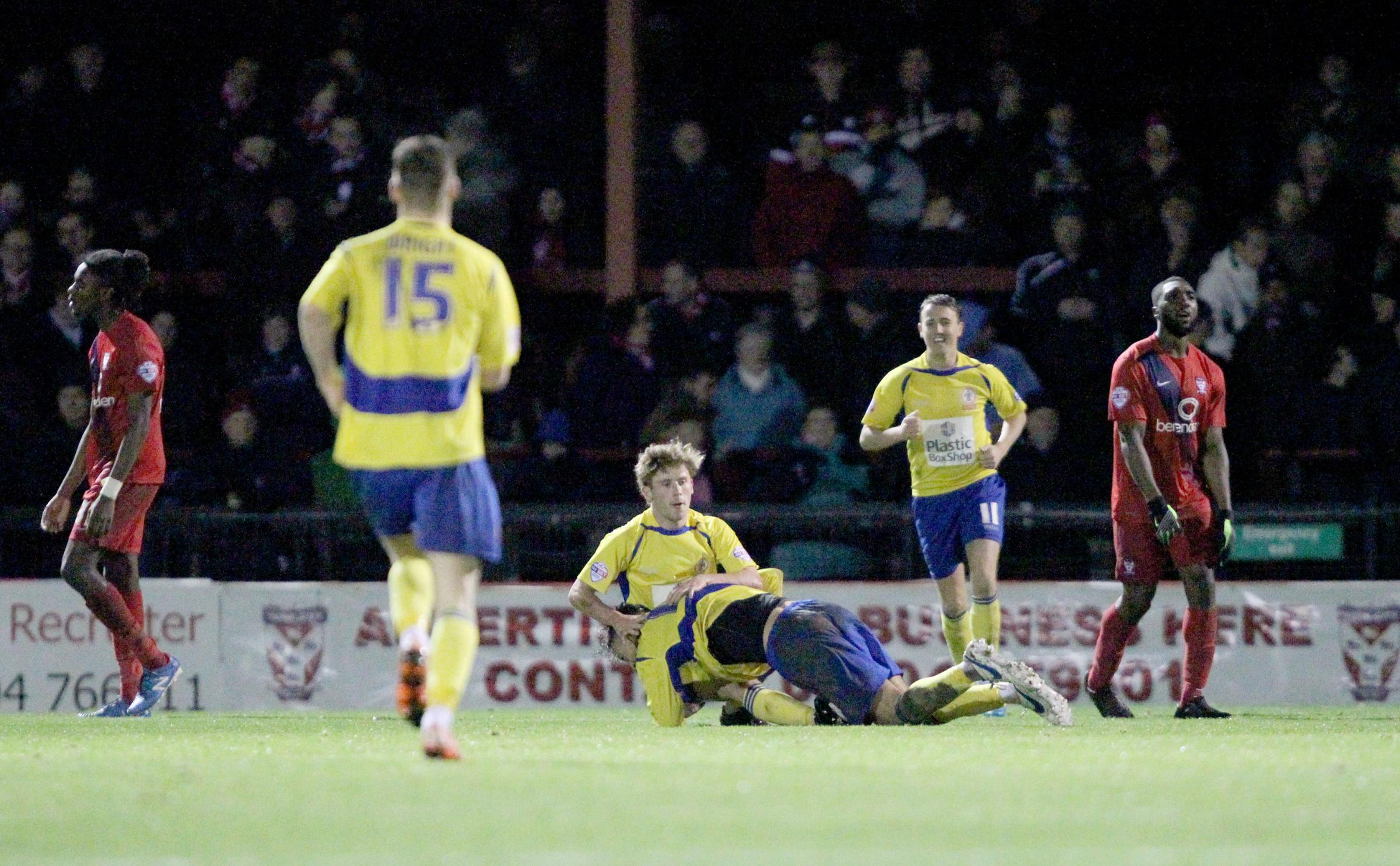 ANOTHER FINE MESS AGAINST STANLEY: York City defenders Stefan O'Connor (left) and Femi Ilesanmi cut forlorn figures as Shay McCartan celebrates the final goal in a 5-1 win for Accrington Stanley. Picture: Gordon Clayton