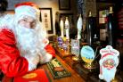 Santa admires the beers at The Waggon & Horses. Landlord Tom Renshaw is mysteriously posted missing.