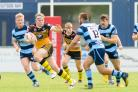 DISCOVERY: Brad Nicholson storms away from Coventry Bears defenders during the League Two match at Butts Park Arena last year