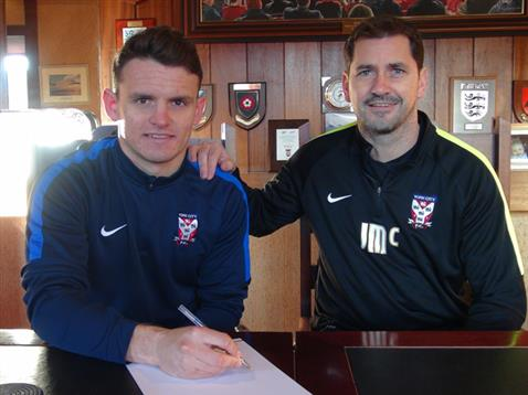 WELCOME ABOARD: Matty Dixon signs for York City, watched by manager Jackie McNamara - Picture courtesy of York City