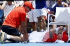 Kyle Edmund of Britain receives treatment from a trainer during his first round match against Damir Dzuhmur of Bosnia and Herzegovina during their first round match at the Australian Open tennis championships in Melbourne, Australia, Monday, Jan. 18, 2016
