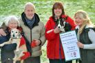The Ryedale Dog Rescue is celebrating its 10th anniversary. Pictured is the first dog they rehomed Sam the Terrier, left, with owners Tom and Denise McAudley, Rosie Stephenson, of Ryedale Rescue, with Pringle and fundraiser Mandy Clar. Pic: Dave Harrison