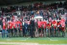 PEDAL POWER: York-to-Northampton charity bike ride participants line up with the two clubs' respective chairmen before the home side's 2-0 triumph. Picture: Gordon Clayton
