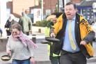 Cllr Andrew Waller takes the lead in the Acomb Alive Pancake Race