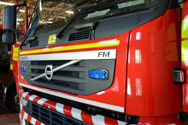 Man taken to hospital with burns after fire breaks out in flat