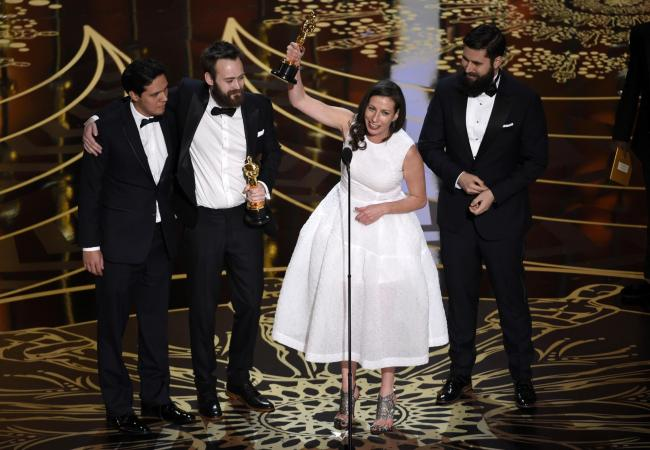 Shan Christopher Ogilvie, from left, Benjamin Cleary, Serena Armitage, and Michael Paleodimos accept the award for best live action short film for Stutterer at the Oscars at the Dolby Theatre in Los Angeles. Picture: Chris Pizzello